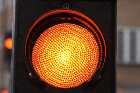 A closeup on a streetlight showing red