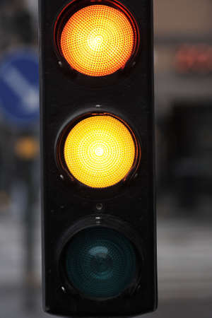 A closeup on a streetlight showing red and yellow photo