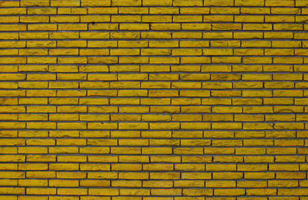 textured wall: A yellow brick wall with a good texture.