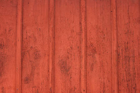 A red painted wooden fence