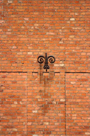 A brick wall with old iron detail