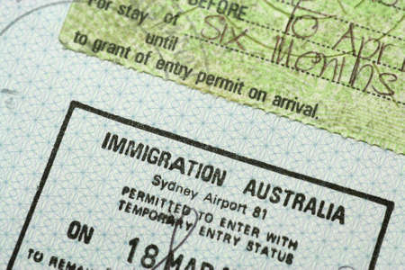 A passport with an Australian immigration stamp
