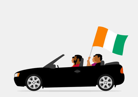 People in car with ivory coast flag