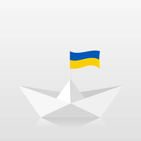 Paper boat with ukraine flag