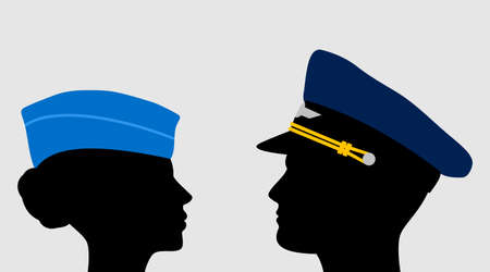 Pilot and stewardess in uniform caps