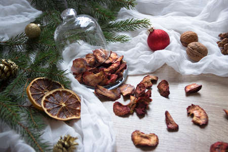 Dried fruits berries strawberries strawberries candied fruits on a table under a glass cap tree cones nuts tissue