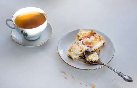 cup of tea and plate with apple pie on white table Stock Photo