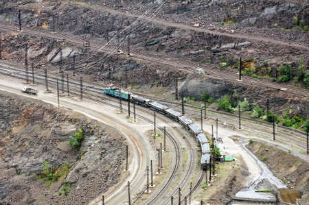 close up of quarry extracting iron ore and wagons photo