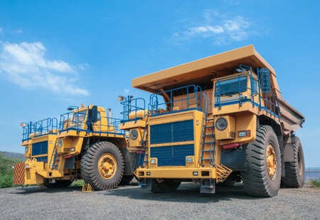 open cast mine: picture of big yellow heavy truck in open cast mine Stock Photo