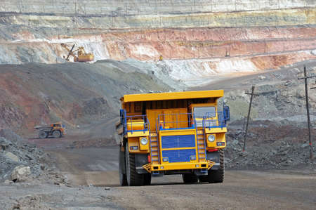 picture of big yellow heavy truck in open cast mine Stock Photo
