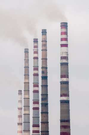 Air pollution by smoke coming out of  factory chimneys photo