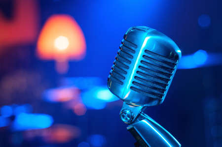 onstage: close up of  metal shining vintage style microphone on stage Stock Photo