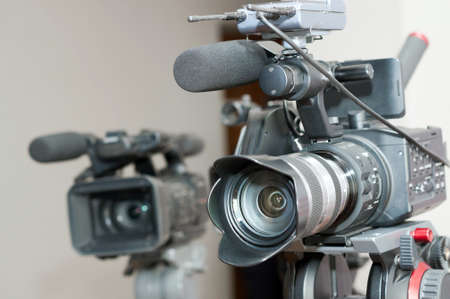 highend: close up of professional  video camera lens in interior.