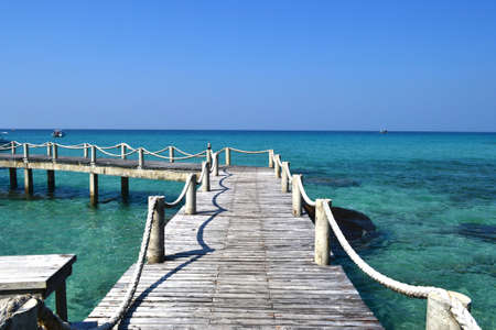 wooden dock: wooden dock on turquoise tropical water