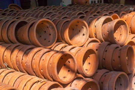 side view of piles of traditional asian pottery Foto de archivo
