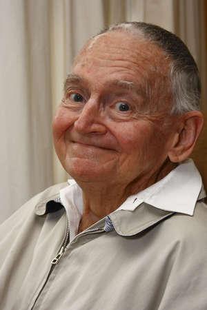 portrait of a senior citizen giving a smile photo