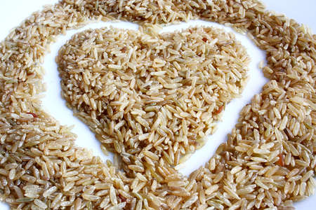 brown rice with a heart showing love Stock Photo