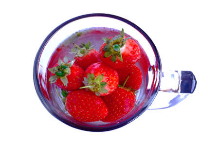 strawberries floating in a mug of water Stock Photo - 2494552