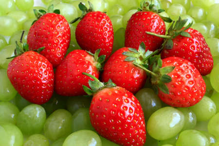 strawberries on a bed of grapes Stock Photo - 2496372