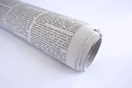 rolled up news paper giving some bad news photo