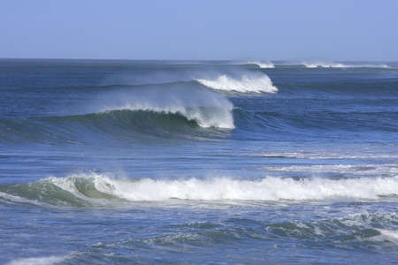 rows of beautiful waves with  sea spray Stock Photo