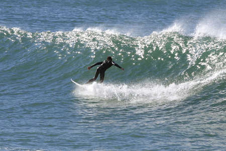 surfer doing a turn on a large wave