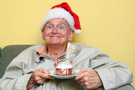 jacked: senior man about to eat some delicious christmas cake Stock Photo