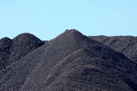 stored: black mountains of coal pieces being stored for shipping Stock Photo