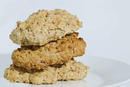 Brown health cookies stacked on a white background Stock Photo - 20947700