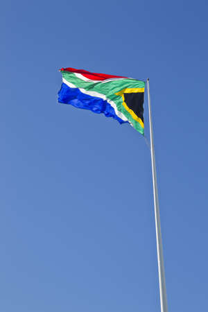 high up: Large South African flag high up on a flag pole