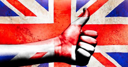 Thumbs up on a British flag with a grunge texture behind photo