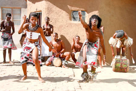 Africans dancing in a local village in Port Elizabeth dancing and playing for tourists 11 April 2014