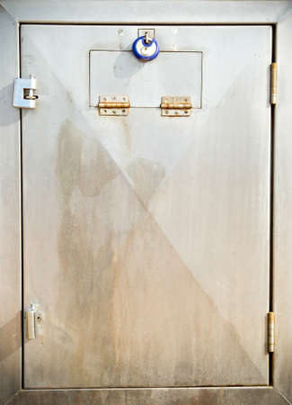 stainless steel door with a steel locks attached photo