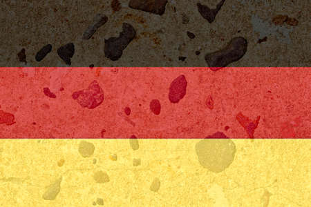 imbedded: German flag on a brown stone background Stock Photo