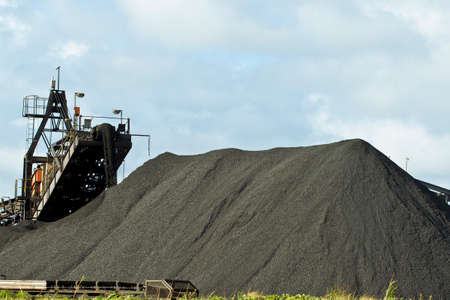 Large machinery creating manganese heaps ready for export