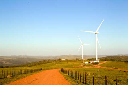 Large wind turbines set on a farm in beautiful scenery Stock Photo