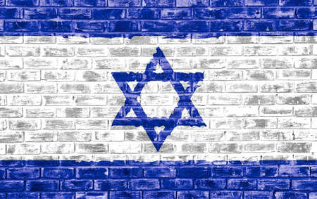Israeli flag on a brick textured wall to be used as a background or wall paper Фото со стока