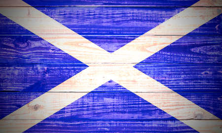 scottish: Scottish flag on an old rough wooden textured background Stock Photo