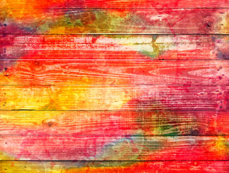 photographic effects: bright mixture of colours on a wooden textured background