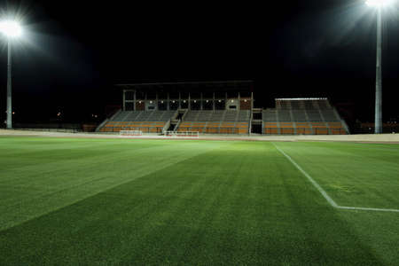 cut the grass: floodlit sports stadium with freshly cut grass and bright flood lights