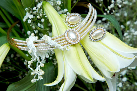 diamond candle: beautiful weeding jewellery placed on white and yellow tubular Lilly flowers