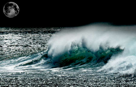 High contrast image of high seas at night in full moon. Some parts of this image have been supplied by NASA