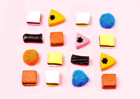 liquorice: liquorice candy made of different bright colours on a pink background Stock Photo