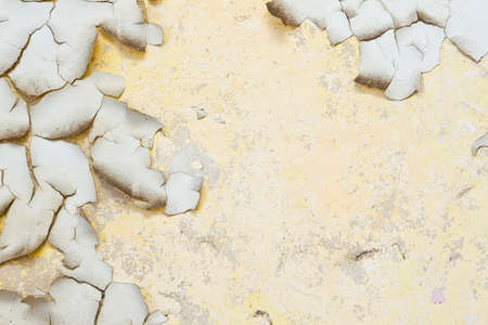 flaky: Old dirty flaky paint on a grungy cracked wall