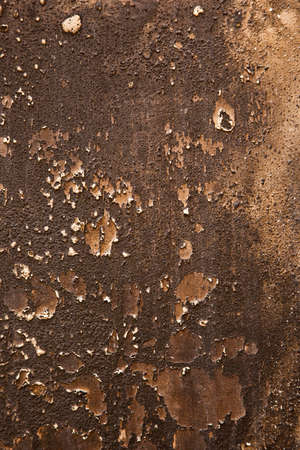 black dark grungy wall with peeling paint and burnt concrete