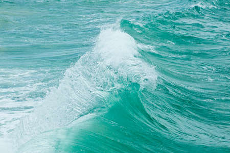 currents: strong backwash currents causing a wave motion before it breaks on the sand Stock Photo