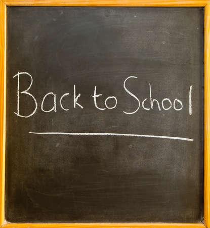 classbook: school blackboard with the words back to school written on it Stock Photo