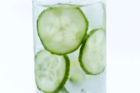fresh drink made from lemon,cucumber and ice to detox the body and quench a thirst