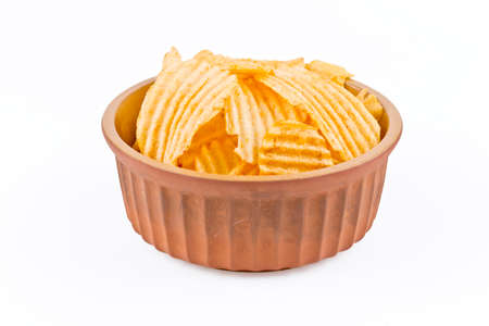 potato crisps: earthenware  bowl with crinkle cut potato crisps isolated on a white background