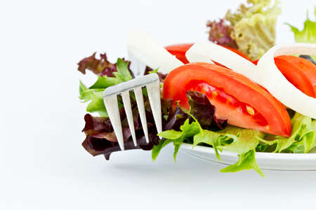 rocket lettuce: simple fresh salad comprising of tomatoes,lettuce,onions on a white Background Stock Photo